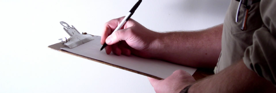 Image of: Man using a clipboard